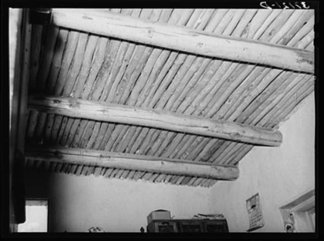 Vigas in Spanish-American home. This is regular ceiling construction on adobe houses. Amalia, New Mexico