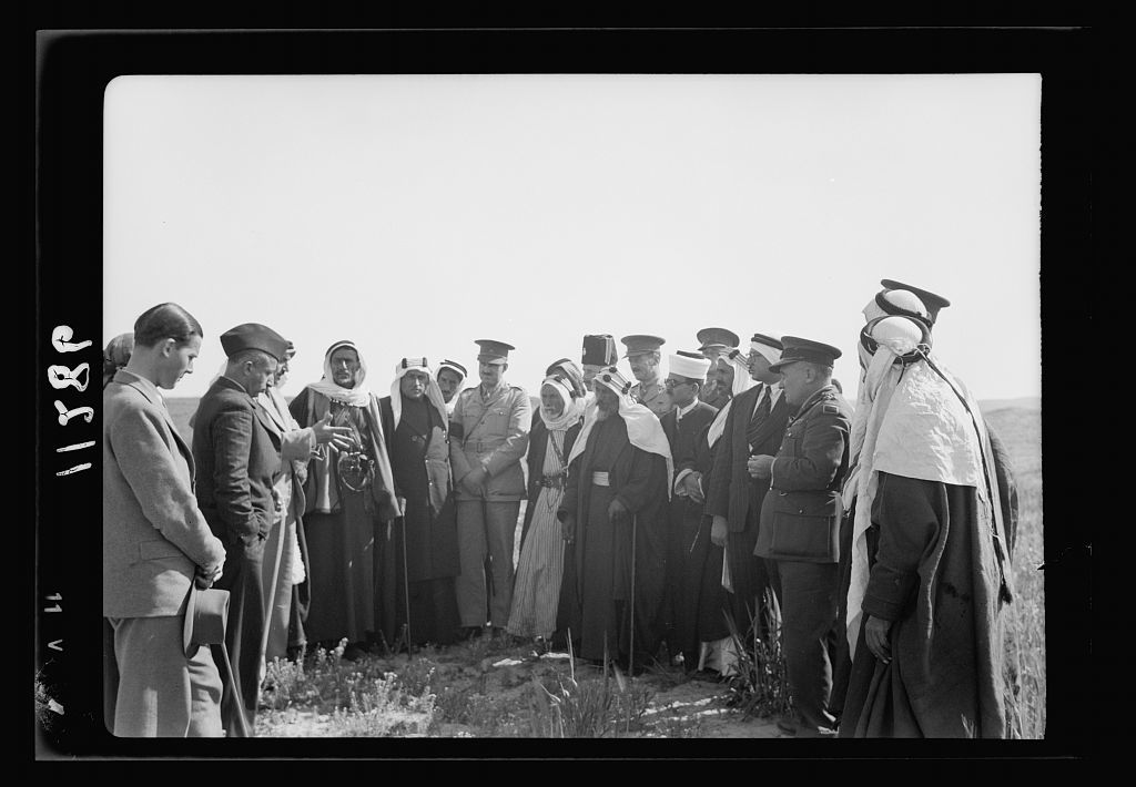 Visit to Beersheba Agricultural Station (Experimental) by Brig. Gen. Allen & staff & talks to Bedouin sheiks of district by station superintendent. Mixed group in field of grain listening to lecture, closer up. Shabi Eff. & Jamal Hammad listening
