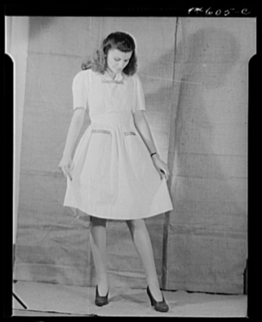 Washington, D.C. Modeling osnaburg pinafore worked out for a high school girl on a low income by graduate students of the Department of Clothing and Textiles, School of Home Economics, University of Alabama. Total cost of materials was fifty-seven cents
