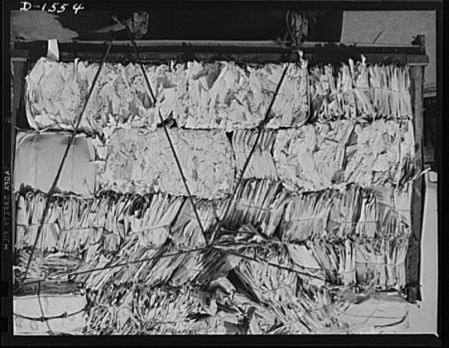 Waste paper. For defense use, this pile of waste paper is being delivered by a dealer to a large Philadelphia paper mill. There it will be chopped up and combined with water, then pressed into pasteboard packing so vitally needed for shipment of defense and lend-lease goods