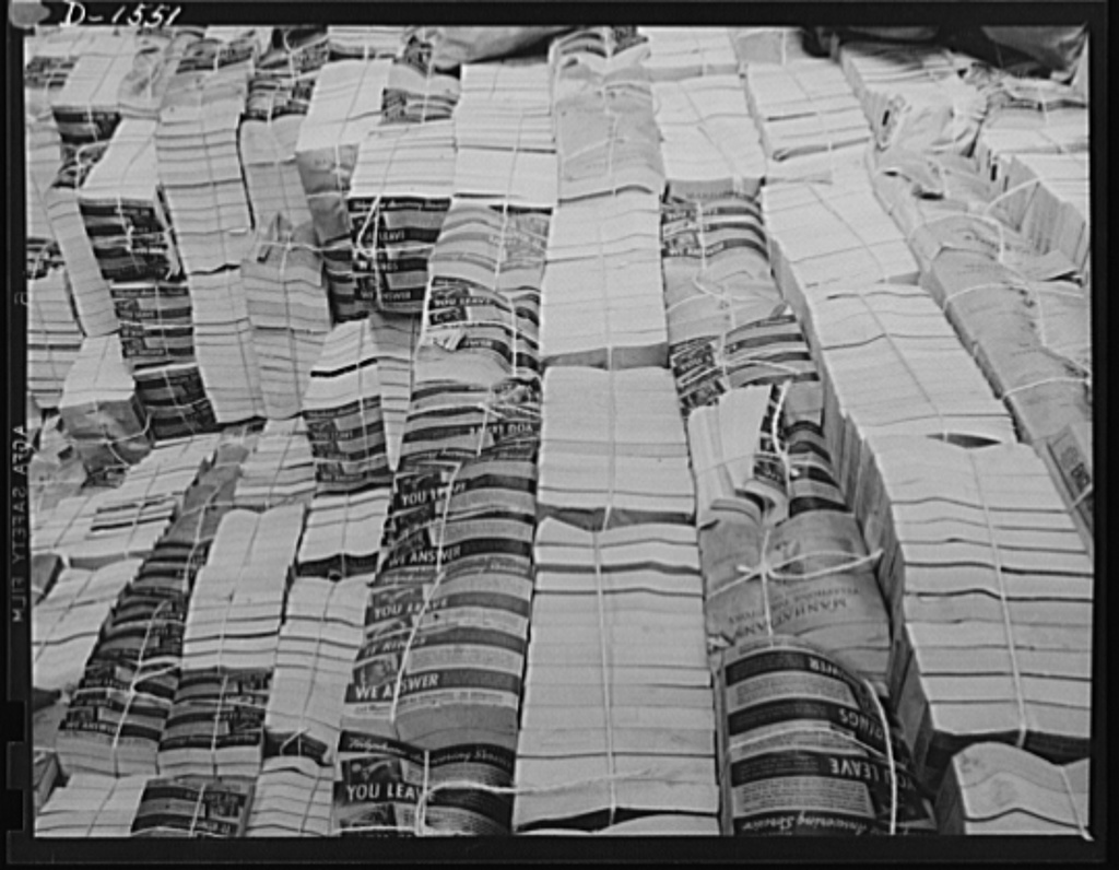 Waste paper. Outdated telephone directories are a good source of the paper packing so badly needed today for shipment of defense and lend-lease goods. This pile of directories is in the stock room of a Philadelphia paper mill, which will make pasteboard packing out of it