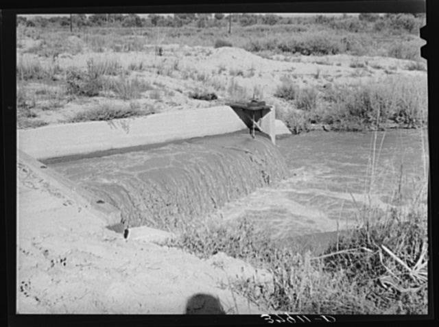 Water in irrigation canal. Bernalillo County, New Mexico