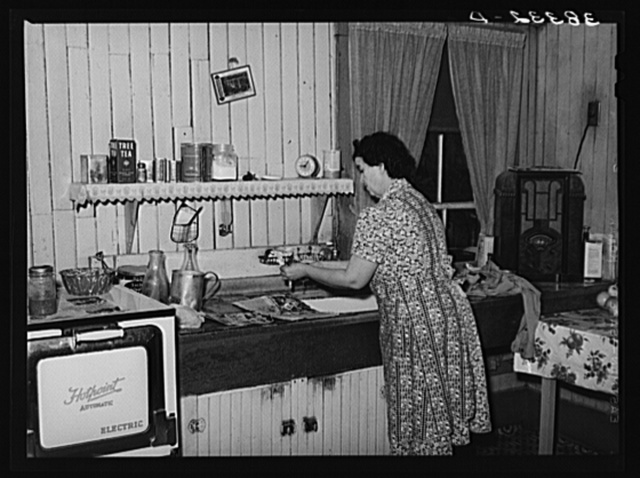 Wife of farmer in her kitchen. Auburn, California. Notice the electric stove, running water and radio. Electrification has been general in this section for twenty years