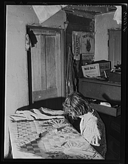 Wife of FSA (Farm Security Administration) rehabilitation borrower sewing a quilt. Grant County, Illinois