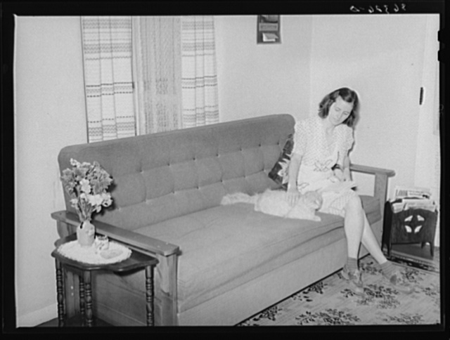 Wife of member of Casa Grande Valley Farms in corner of their living room. Pinal County, Arizona