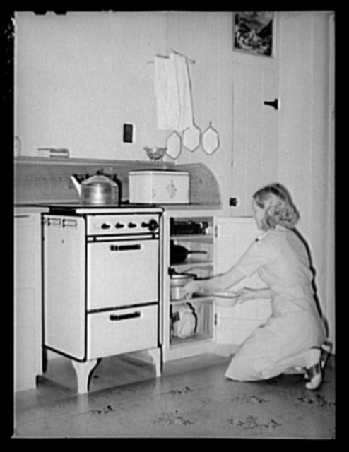 Wife of member of the Arizona part-time farms, Chandler Unit, Maricopa County, Arizona, at her kitchen stove