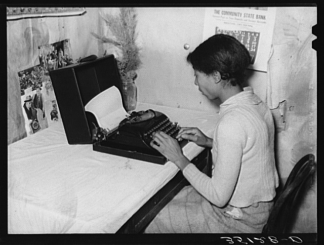 Wife of Pomp Hall, Negro tenant farmer, writing on typewriter. Through union activities this family has developed a desire for higher education. This typewriter is to them a symbol of that education and as such is the most prized family possession. Creek County, Oklahoma. See general caption no. 23