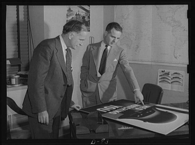 William B. Phillips, left, Chief, Publications Section, Information Division, Office of Emergeny Management (OEM); and Robert W. Horton, right, Director, Information Division, OEM