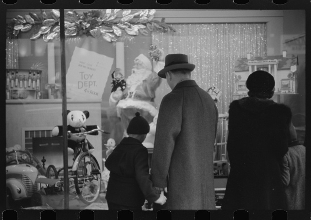 Window shoppers watching toy display in downtown Providence, Rhode Island
