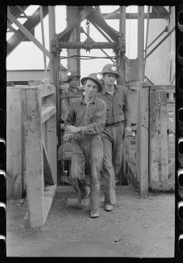 Workers in gold mine coming out of cage which brings them to the surface at the end of the day's work. Mogollon, New Mexico