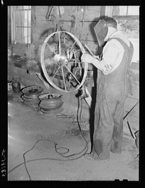 Working in blacksmith shop. Community service center, Faulkner County, Centerville, Arkansas (see general caption)