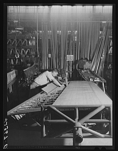 Working on a wing assembly at the Vought Sikorsky Aircraft Corporation. Stratford, Connecticut