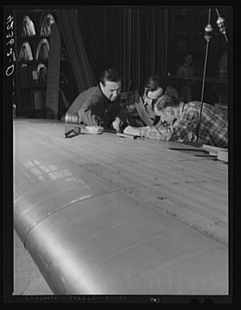 Working on an aileron assembly of a wing at the Vought Sikorsky Aircraft Corporation. Stratford, Connecticut