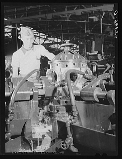 Working on an aircraft engine casing at the Pratt and Whitney Aircraft plant in East Hartford, Connecticut