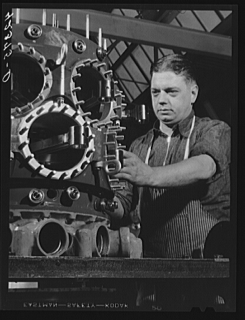 Working on the assembly of a Pratt and Whitney Engine. At the plant in East Hartford, Connecticut