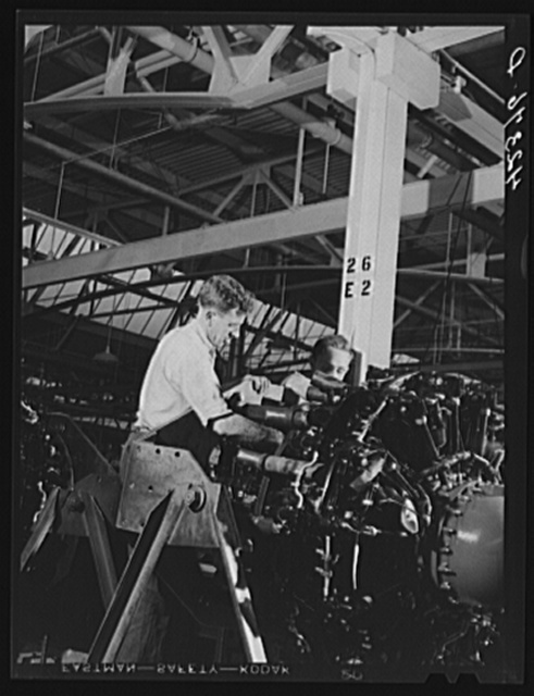 Working on the final assembly of Pratt and Whitney Aircraft motors at the plant in East Hartford, Connecticut