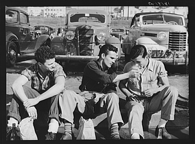 Workmen during lunch period, across the street from the Consolidated Airplane Factory. San Diego, California