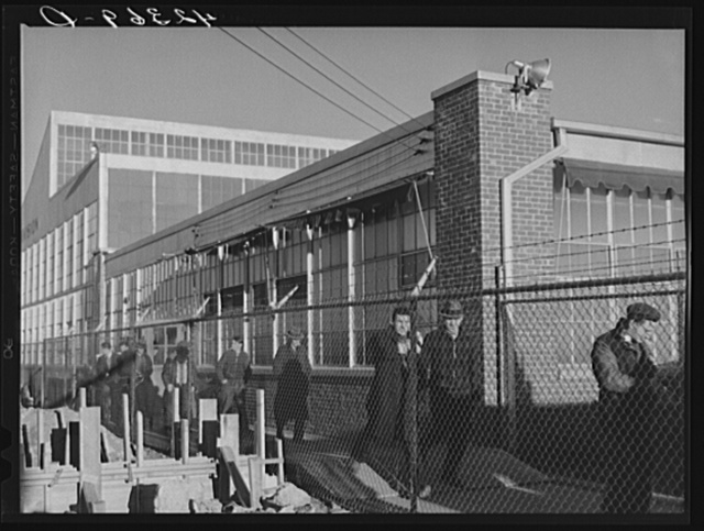 Workmen leaving the plant at the Vought Sikorsky Aircraft Corporation. Stratford, Connecticut