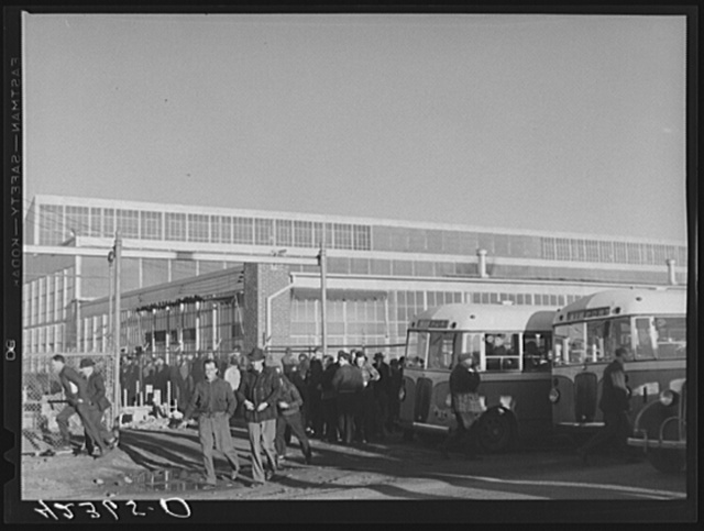 Workmen leaving the plant at Vought Sikorsky Aircraft Corporation. Stratford, Connecticut