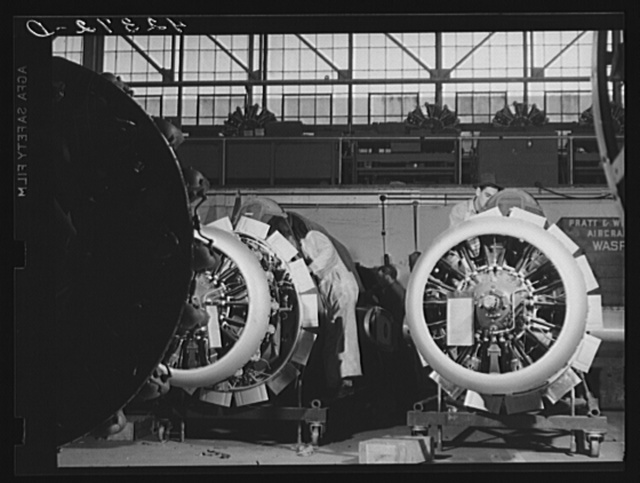 Workmen on the final assembly of a plane at the Vought Sikorsky Aircraft Corporation. Stratford, Connecticut