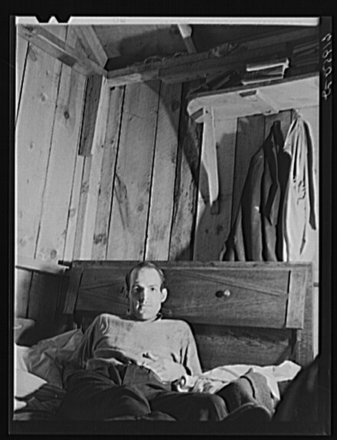 W.W. McDaniel, rigger at Hercules powder plant, in his bunkhouse in the rear of Mrs. Pritchard's boardinghouse. Radford, Virginia