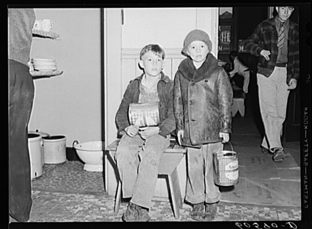 Young boys waiting in kitchen of city mission for soup which is given out nightly. Dubuque, Iowa