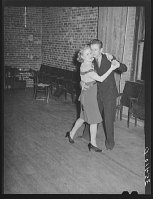 Young couple dancing at Jaycee buffet supper and party. Eufaula, Oklahoma