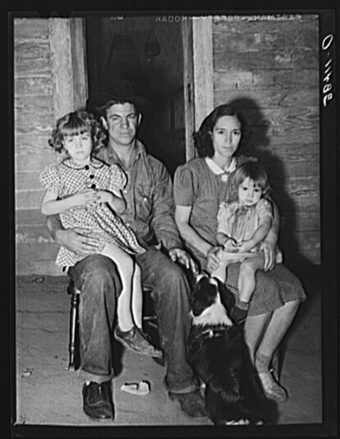Young man, his wife and children. They came from Oklahoma with his father and mother. His father has bought a farm and expects to get some cash from his fruit and supplement his income with garden, pigs and chickens, a thing unheard of in this section of fruit specialists. Placer County