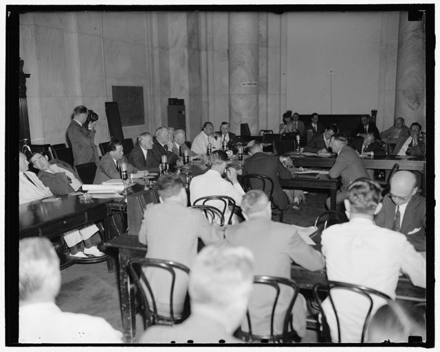 Col. Knox appears before Senate Naval Affairs Committee. Washington, D.C., July 2. A general view of the Senate Naval Affairs Committee room as Col. Frank Knox testified today regarding his qualifications to be secretary of the Navy. Knock can bee seen on the right facing the Committee, 7-2-40