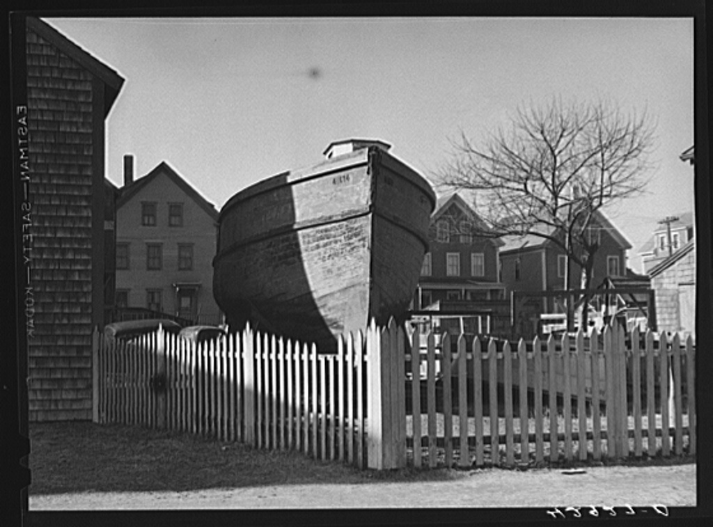 A boat in backyard of house along the waterfront in New Bedford, Massachusetts