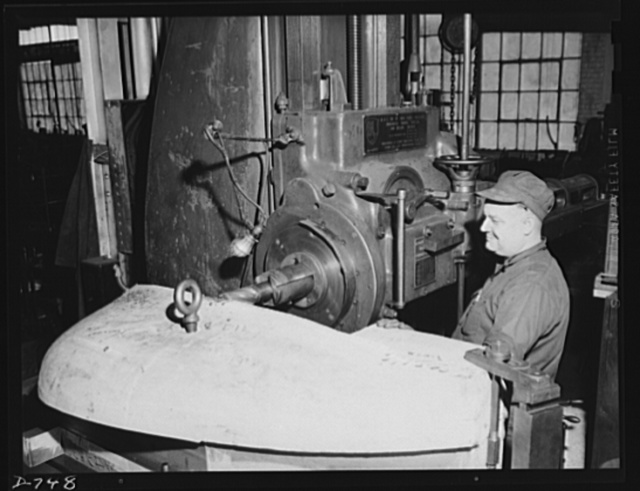 A boring mill machining a cast-iron die which, when finished, will be used to stamp out automobile fenders. Plant of Frederick Colman & Sons, Inc., Detroit, Michigan