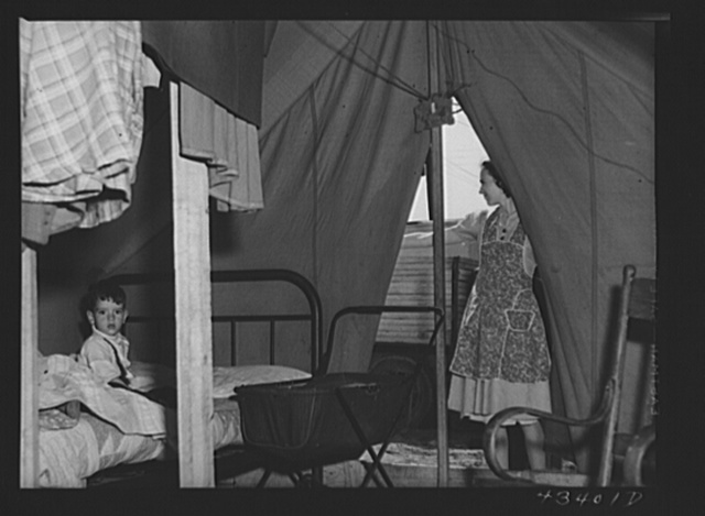 A family from the southern part of Texas occupies this tent. Husband works at Fort Bragg, but they expect to move on soon. In a settlement near Manchester, North Carolina