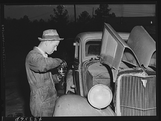 A major motor repair job at one of the settlements of workers from Fort Bragg. Near Manchester, North Carolina