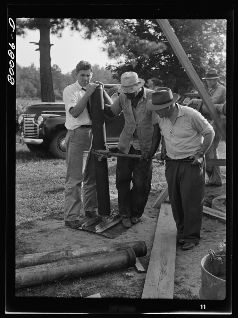 A steel plate with a pipe coupling is placed on the culvert cap. Safe well demonstration near La Plata, Maryland. Charles County
