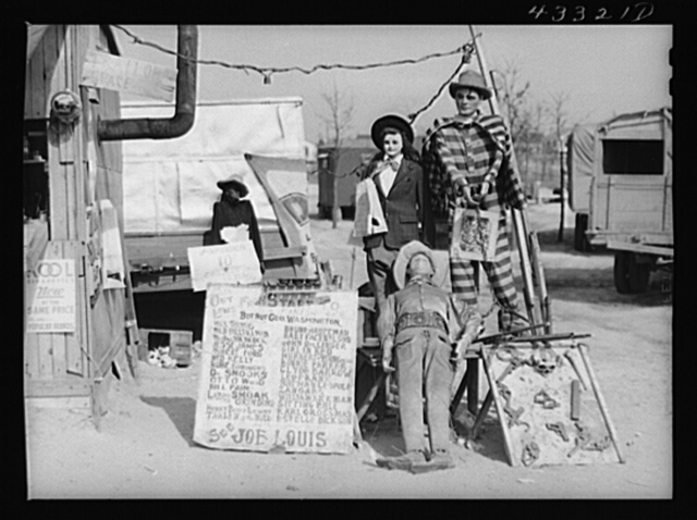 """A traveling side-show. """"Crime Museum,"""" consisting of a dilapidated effigies of famous criminals run by an old, shellshocked World War veteran. Near Silver Lake, North Carolina"""