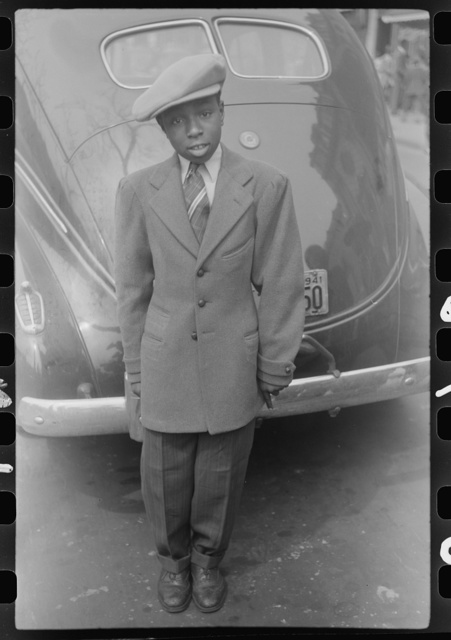 Adolescent boy dressed up for the Easter parade, Chicago, Illinois