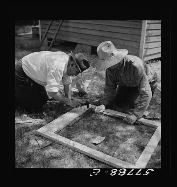 All joints on the outside face are reinforced first. Screen door construction demonstration. Charles County., La Plata, Maryland