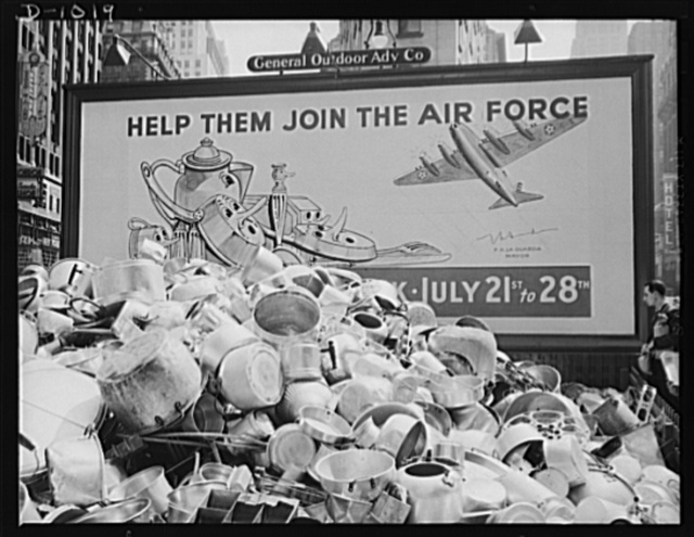 Aluminum collection. A store window display in New York, New York, promoting the National Defense Aluminum Collection (July 21-29, 1941). This collection was conducted by the Office of Civilian Defense and some of the aluminum obtained will be for use in industries producing for national defense. Much of the lower grade aluminum collected which cannot be used directly for this purpose will be used to replace new aluminum in the manufacture of consumer goods, and hence release this new aluminum for use in defense production