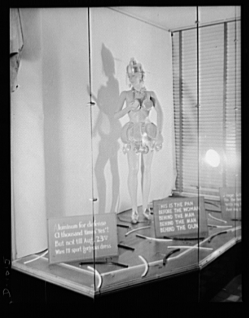 Aluminum collection. A store window display in Rutherford, New Jersey, promoting the National Defense Aluminum Collection (July 21-29, 1941). This collection was conducted by the Office of Civilian Defense and some of the aluminum obtained will be for use in industries producing for national defense. Much of the lower grade aluminum collected which cannot be used directly for this purpose will be used to replace new aluminum in the manufacture of consumer goods, and hence release this new aluminum for use in defense production