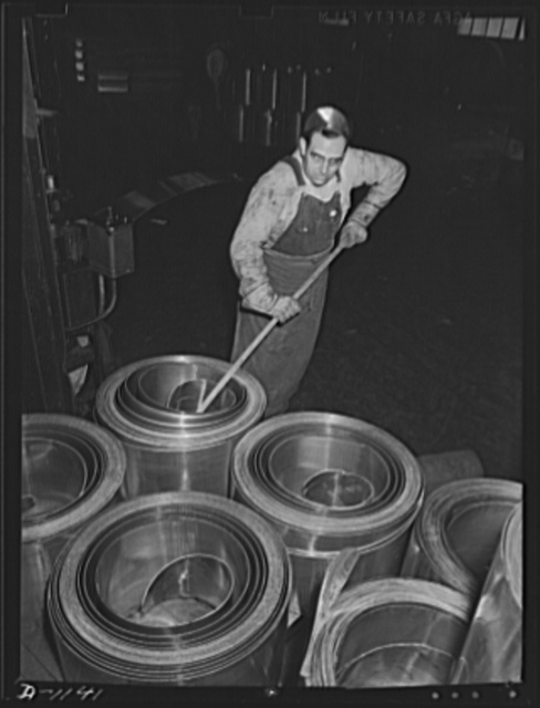 Aluminum. Reynolds Metal Company, Louisville, Kentucky. Coils of sheet aluminum for stamping into powder cans as part of the national defense production program