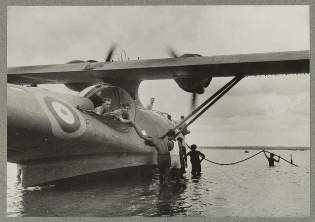American Catalinas in the Far East For several months past American built Catalina Flying Boats have been patrolling the Indian Ocean and China Seas .... Photo shows Tamil coolies helping to launch a Catalina down the slipway.