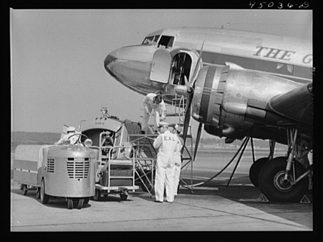 An airliner taking on baggage and fuel. Washington, D.C. municipal airport