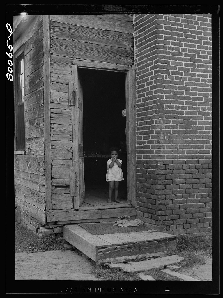 An unscreened door is an invitation for flies and illness near La Plata, Maryland. Charles County