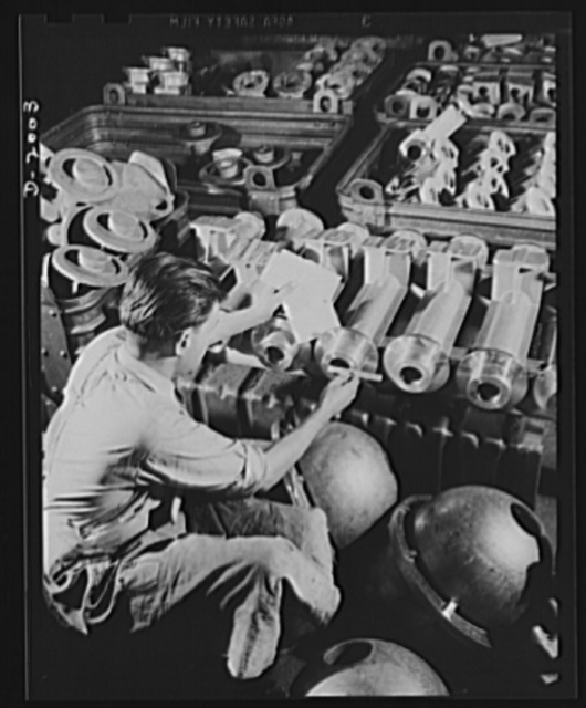 Antiaircraft gun carriage. Inspection of a thirty-seven millimeter antiaircraft gun carriage parts. With 300-plus-mile-per-hour planes for targets, antiaircraft assembly must be a precision instrument to permit the gunner to keep on his target. Inspection is as rigid as in instrument manufacture. War program production scene in one of Pennsylvania's heavy industry plants now converted to the production of vitally needed military equipment. AETNA. Ellwood City, Pennsylvania