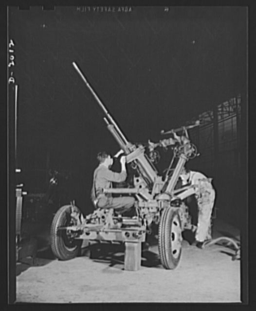 Antiaircraft gun carriage workers. Workers assembling the elevating mechanism of one of America's many new thirty-seven-millimeter antiaircraft gun carriages. These guns will soon take their place in the protection of our soil against the best-armoured and the fastest-flying planes that our enemies can produce. Scene in a Pennsylvania engineering plant now converted almost entirely to America's war program production. AETNA. Ellwood City, Pennsylvania