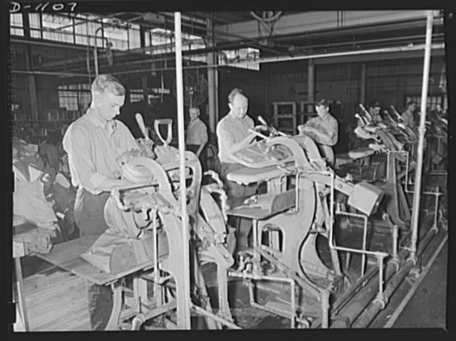 Army uniform trouser manufacture. Kane Manufacturing Company, Louisville, Kentucky. The first of the many pressings these trousers will receive during their period of services with the expanding Army. These trousers have been closely inspected and are now ready for shipment