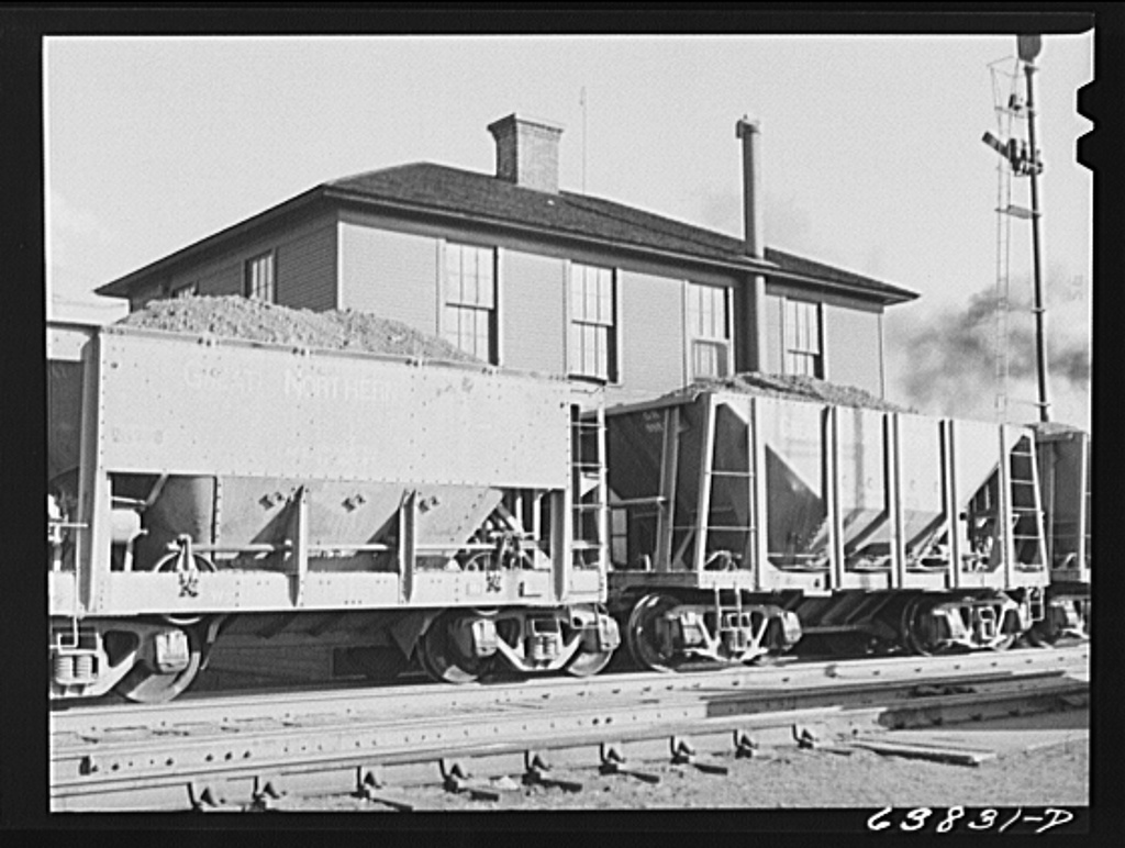 At Great Northern Railroad yards, cars of iron ore passing over the scales are weighed at the rate of three and a half a minute. Superior, Wisconsin
