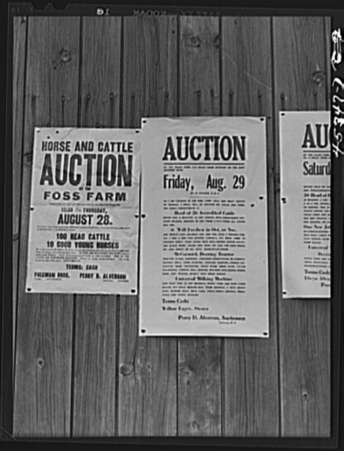 Auction notices of farms in the Pine Camp expansion area posted on a barn at the Ingalls farm near Antwerp, New York
