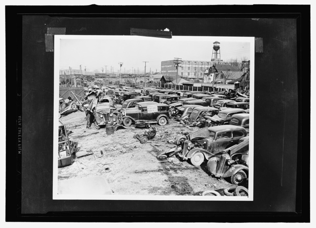 Auto graveyard. A Detroit auto graveyard. Junked autos and trucks to be shipped to scrapyards and then to the Great Lakes Steel Plant