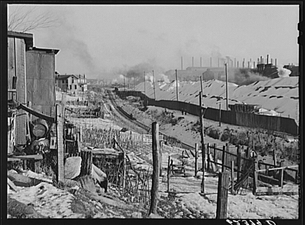 Backyards of company houses and steel mill. Midland, Pennsylvania